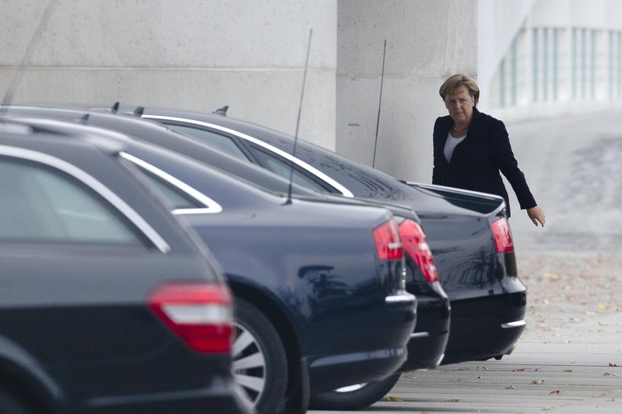 German Chancellor Angela Merkel arrives at the Chancellery in Berlin on Monday, Oct. 24, 2011, to brief lawmakers on Sunday's European Union summit on the euro financial crisis. (AP Photo/Markus Schreiber)