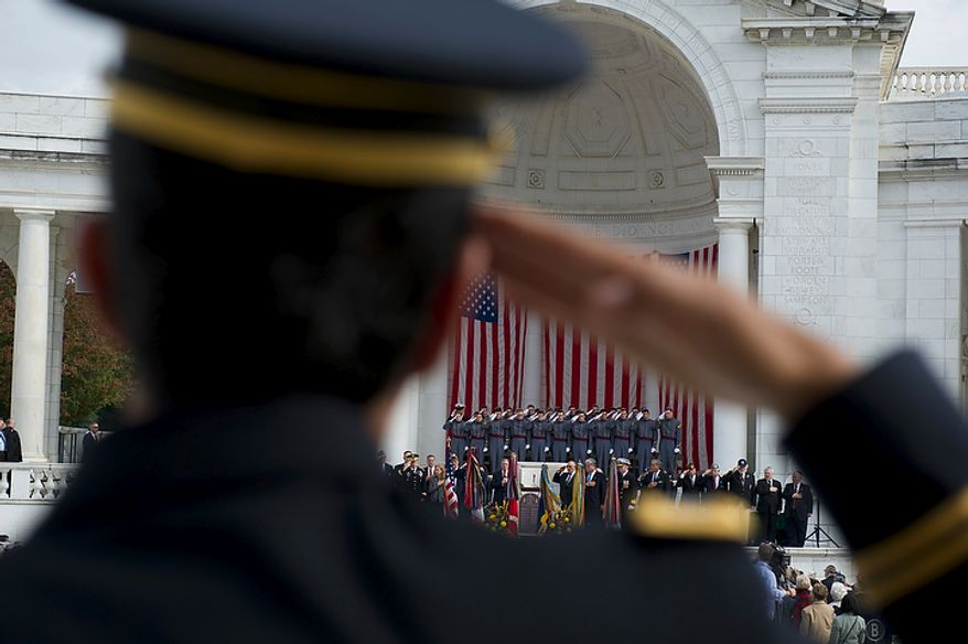 New York Army National Guard  Chaplain1st. Lt. Raziel Amar salutes during the sining of the National Anthem  during the dedication of the Jewish Chaplains Memorial in the Memorial Amphitheater at Arlington National Cemetery in Arlington, Va, Monday, October 24, 2011. (Rod Lamkey Jr/The Washington Times)