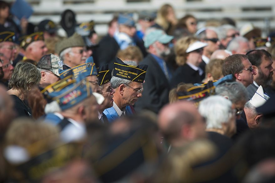 Jewish war veterans listen to speakers during the dedication of the Jewish Chaplains Memorial in the Memorial Amphitheater at Arlington National Cemetery in Arlington, Va, Monday, October 24, 2011. (Rod Lamkey Jr/The Washington Times)