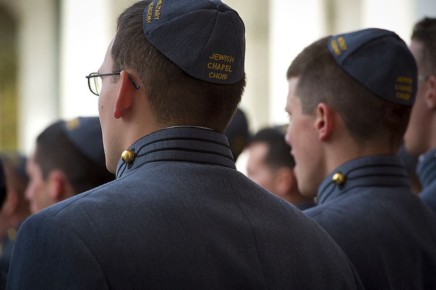 Members of The West Point Jewish Chapel Cadet Choir prepare for the dedication of the Jewish Chaplains Memorial in the Memorial Amphitheater at Arlington National Cemetery in Arlington, Va, Monday, October 24, 2011. (Rod Lamkey Jr/The Washington Times)