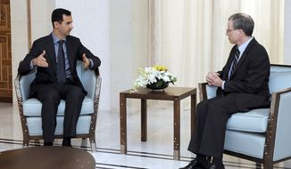 ** FILE ** Syrian President Bashar Assad (left) meets with Robert Ford, the new U.S. ambassador to Syria, in Damascus, Syria, in Thursday, Jan. 27, 2011. (AP Photo/Syrian Arab News Agency, File)