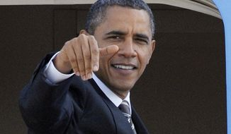 President Obama waves as he boards Air Force One at Andrews Air Force Base, Md., on Oct. 24, 2011. (Associated Press)