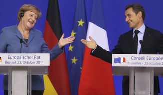 German Chancellor Angela Merkel and French President Nicolas Sarkozy give a joint media conference at the European Union summit in Brussels on Sunday, Oct. 23, 2011. (AP Photo/Michel Euler)