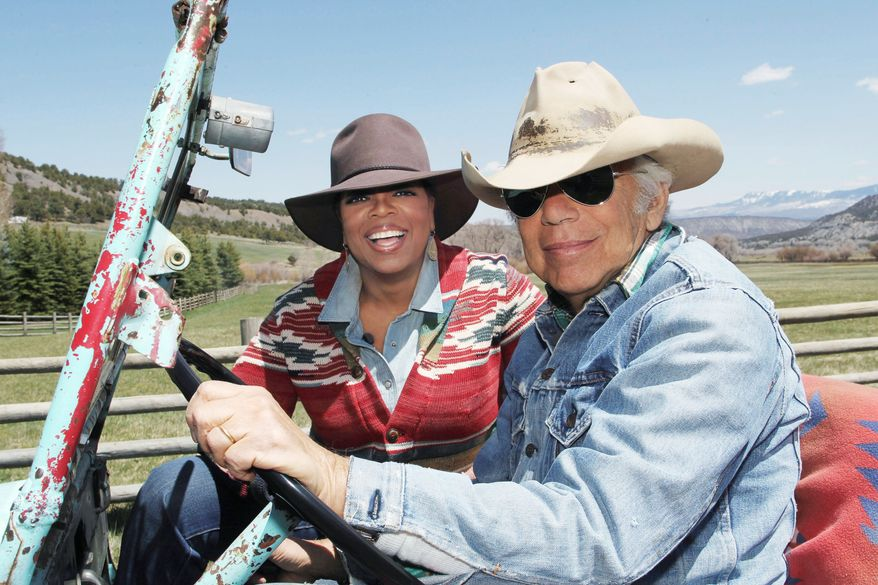 ** FILE ** In this file photo taken May 7, 2011, provided by Harpo Productions Inc., talk-show host Oprah Winfrey rides in a jeep with fashion designer Ralph Lauren at Lauren's RRL Ranch outside Telluride, Colo. (AP Photo/Harpo Productions, Inc. George Burns, FILE)