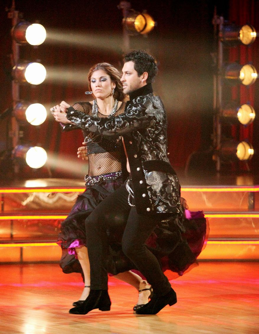 Soccer player Hope Solo and her partner Maksim Chmerkovskiy landed near the bottom of the judges' scoring on Monday, prompting Mr. Chmerkovskiy to lash out at the head judge. (ABC via Associated Press)