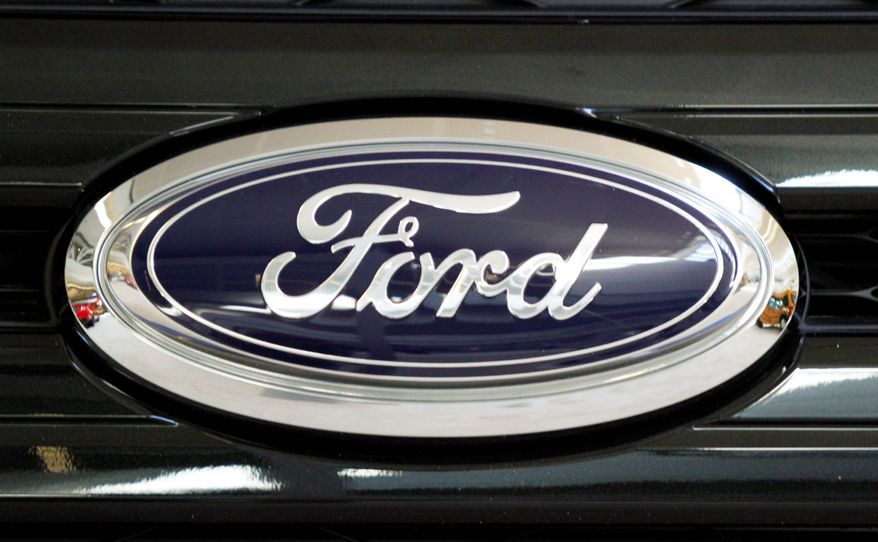 The Ford emblem appears on the 2011 Ford Edge Sport AWD. Consumer Reports said Ford's quality has slipped in the past year because of problems with transmissions and touch-screen systems in some new models. (Associated Press)