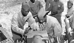"""Members of the Montford Point Marines train with artillery in New River, N.C., in April 1945. The House voted 422-0 Tuesday to award the unit the Congressional Gold Medal. """"They served with great valor and distinction and loved their country more than their country loved them at the time,"""" Rep. Brad Miller, North Carolina Democrat, said. (U.S. Marine Corps via Associated Press)"""