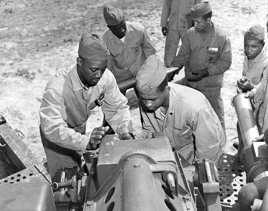 "Members of the Montford Point Marines train with artillery in New River, N.C., in April 1945. The House voted 422-0 Tuesday to award the unit the Congressional Gold Medal. ""They served with great valor and distinction and loved their country more than their country loved them at the time,"" Rep. Brad Miller, North Carolina Democrat, said. (U.S. Marine Corps via Associated Press)"