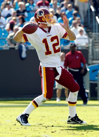 Redskins quarterback John Beck completed 22 of 37 passes for 279 yards with a touchdown and an interception against Carolina . But he's also demonstrated a willingness to scramble, rushing for a touchdown in each of the past two games. (Associated Press)