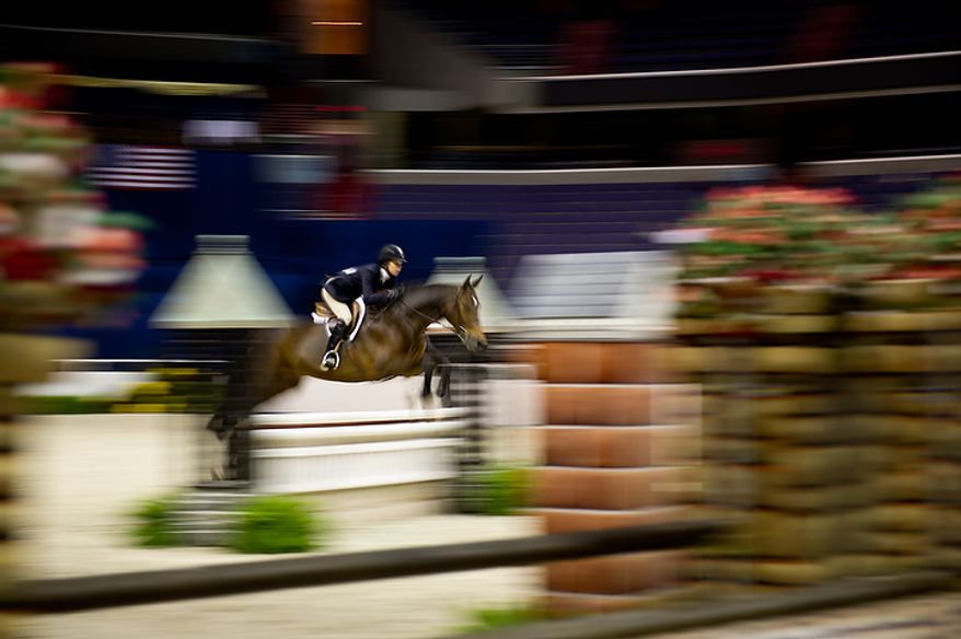 "Liza Boyd of Los Angeles rides her horse ""Arcadia"" at the annual Washington International Horse Show on Oct. 25, 2011, in D.C. The event runs Oct. 25-30 at the Verizon Center and features top riders and horses competing from the U.S. and abroad. (Andrew Harnik/The Washington Times)"