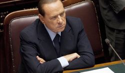 ** FILE ** Italian Premier Silvio Berlusconi looks on after speaking in the lower chamber of parliament in Rome on Thursday, Oct. 13, 2011. (AP Photo/Andrew Medichini, File)