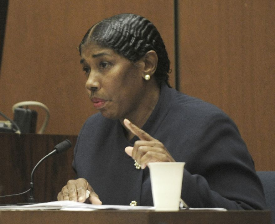 Cheryln Lee, a nurse who treated Michael Jackson for sleep disorder in early 2009, testifies Oct. 24, 2011, during Dr. Conrad Murray's involuntary manslaughter trial at Los Angeles Superior Court. Murray has pleaded not guilty and faces four years in prison and the loss of his medical licenses if convicted of involuntary manslaughter in Michael Jackson's death. (Associated Press)