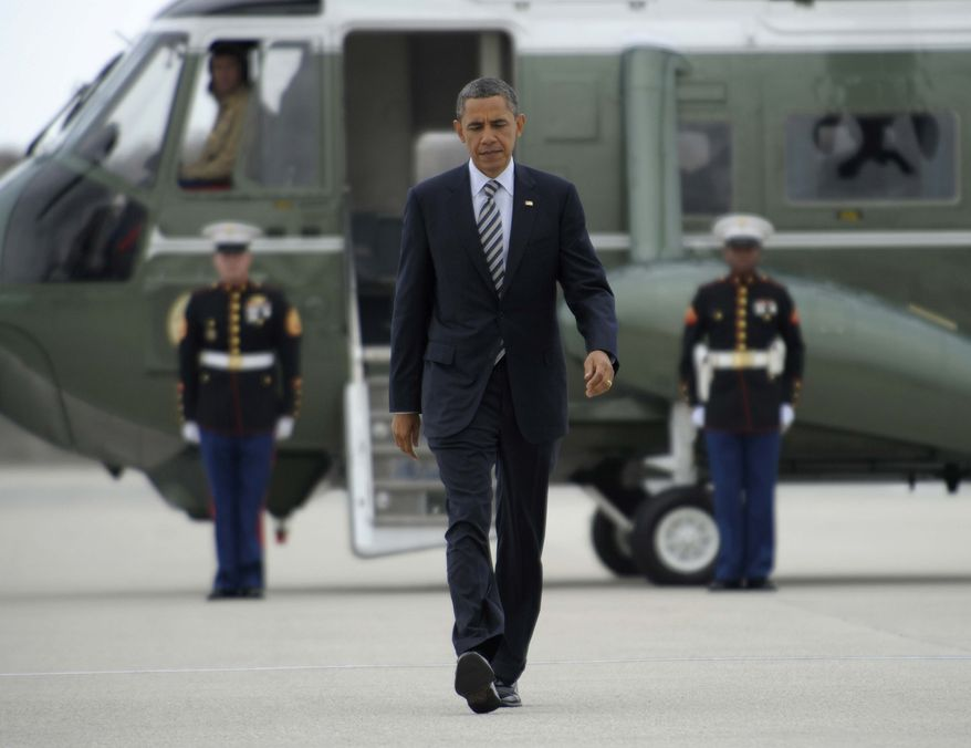 President Barack Obama arrives at Los Angeles International Airport to board Air Force One in Los Angeles, Tuesday, Oct. 25, 2011, to head to a fundraiser in San Francisco. (AP Photo/Susan Walsh)