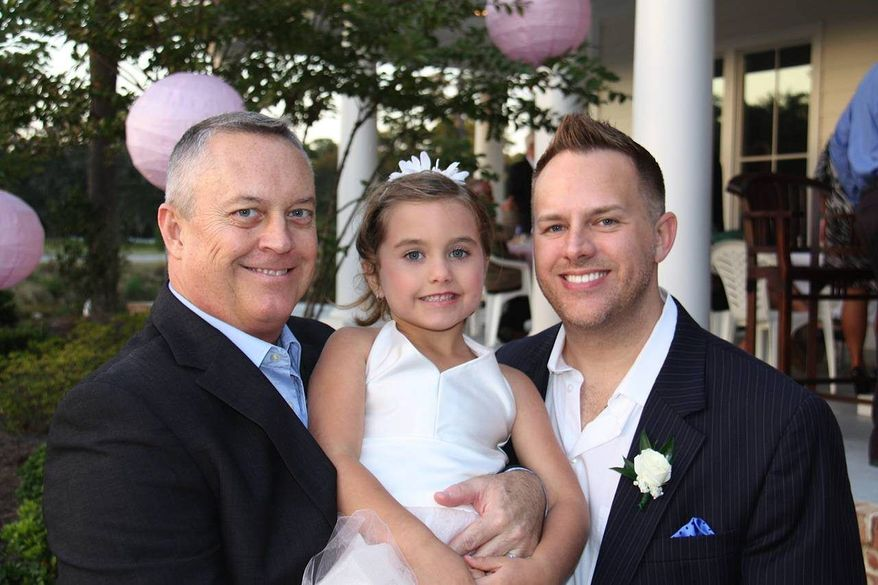Jeff Littlefield (left) and his husband Tommy Starling attend a friend's wedding in Pawley's Iland, S.C. with their 5-year-old daughter, Carrigan Starling-Littlefield. The two men became parents through a surrogacy program in California and later got married during a brief period when same-sex marriage was legal in California. (Associated Press)