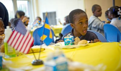Israel Walston, 5, tries some traditional Swedish food in the cafeteria of Miner Elementary School during Prince Daniel of Sweden's visit. (Rod Lamkey Jr./The Washington Times)