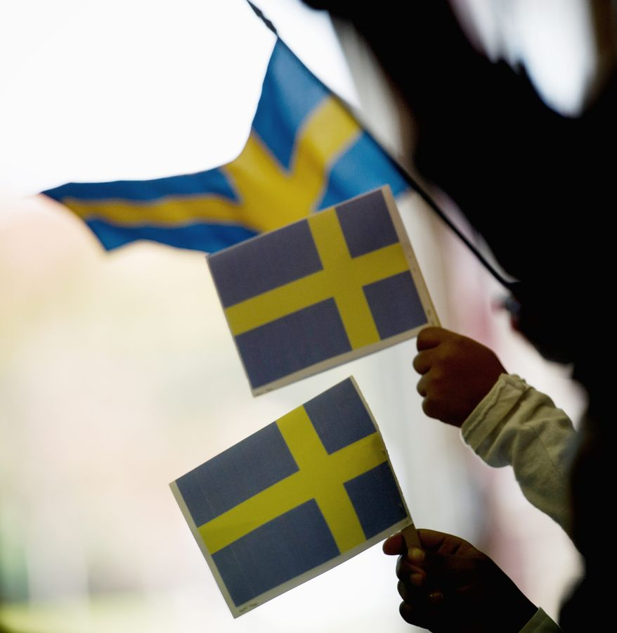 Myrtilla Miner Elementary School students wave the Swedish national flag as they await for the arrival of H.R.H. Prince Daniel of Sweden for his visit to Myrtilla Miner Elementary School in Washington, D.C., Wednesday, Oct. 26, 2011. (Rod Lamkey Jr./The Washington Times)