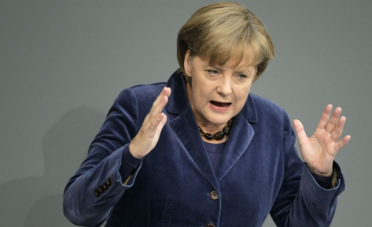 German Chancellor Angela Merkel addresses the German parliament on the European debt crisis on Wednesday, Oct. 26, 2011, at the Reichstag in Berlin. (AP Photo/