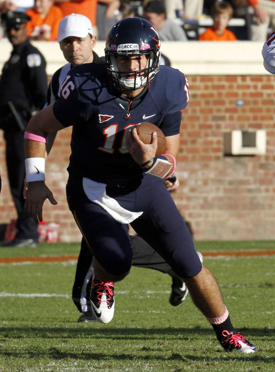 Virginia quarterback Michael Rocco runs the ball during the first half of an NCAA College football game against North Carolina State at Scott Stadium in Charlottesville, Va., Saturday, Oct. 22, 2011. (AP Photo/Steve Helber)