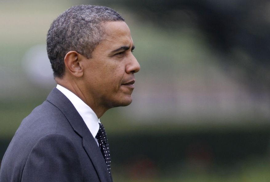 President Obama walks on the South Lawn of the White House in Washington on Wednesday, Oct. 26, 2011, as he returns from a three-day trip to Nevada, California and Colorado. (AP Photo/Charles Dharapak)