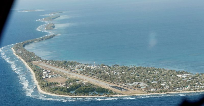 In this Oct. 13, 2011 photo, Funafuti, the main island of the nation state of Tuvalu, is seen from a Royal New Zealand airforce C130 aircraft as it approaches at Funafuti, Tuvalu, South Pacific. Funafuti is the capital of Tuvalu, a group of atolls situated north of Fiji and northwest of Samoa, in the South Pacific ocean. The atolls are suffering a severe drought and water shortage, coupled with contaminated ground water due to rising sea levels. The governments of Australia, New Zealand and the United States are providing desalination plants to alleviate the critical water shortage for some 10,000 islanders. (AP Photo/Alastair Grant)