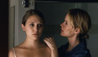 "Elizabeth Olsen (left, with Sarah Paulson) plays Martha in ""Martha Marcy May Marlene,"" a movie that gets inside her messed-up head by keeping the audience as on-edge as she is. (Fox Searchlight via Associated Press)"
