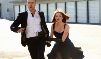"""Justin Timberlake and Amanda Seyfried are on the run in a race against the clock and pursuers in the film """"In Time."""""""
