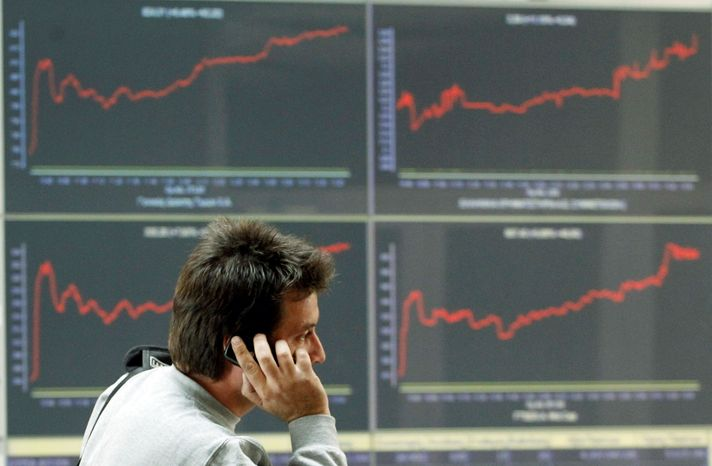 Screens show graphs of stocks on the uptick at the Athens Stock Exchange on Thursday after a new European debt relief deal was hailed by embattled Socialist government as a major breakthrough. In the U.S., the Dow Jones industrial average gained 339 points, closing above 12,000 for the first time in nearly three months. (Associated Press)