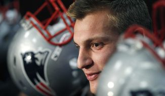 New England Patriots tight end Rob Gronkowski talks to reporters during an availability prior to football practice Wednesday, Oct. 26, 2011, in Foxborough, Mass. The Patriots are scheduled to play the Pittsburgh Steelers on Sunday, Oct. 30, 2011, in Pittsburgh. (AP Photo/Charles Krupa)