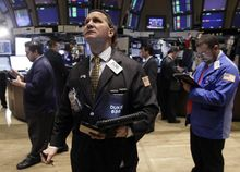 Trader Edward Curran (center) works on the floor of the New York Stock Exchange on Thursday, Oct. 27, 2011. (AP Photo/Richard Drew)