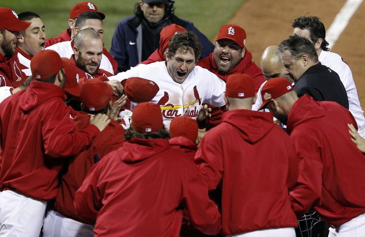 Teammates celebrate with St. Louis Cardinals' David Freese after Freese hit a walk-off home run during the 11th inning of Game 6 the World Series against the Texas Rangers on Thursday, Oct. 27, 2011, in St. Louis. The Cardinals won the game 10-9 to tie the Series 3-3. (AP Photo/Eric Gay)