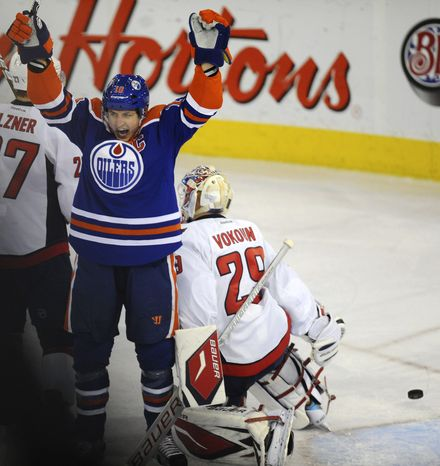 Edmonton Oilers' Shawn Horcoff celebrates what ended up as the game-winning goal against the Washington Capitals by teammate Jordan Eberle