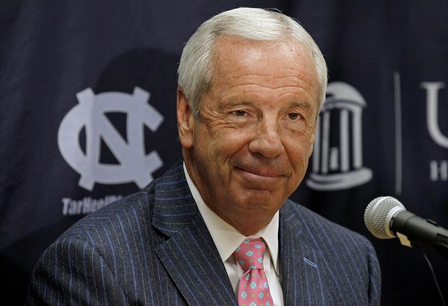 In this Oct. 13, 2011 photo, North Carolina coach Roy Williams smiles while speaking with reporters during NCAA basketball media day in Chapel Hill, N.C., The Tar Heels, who return all five starters from the team that reached the regional finals last season, were the runaway No. 1 in The Associated Press' men's preseason Top 25 on Friday. It is the eighth time they have received that honor since the preseason poll started in 1961-62. (AP Photo/Gerry Broome)
