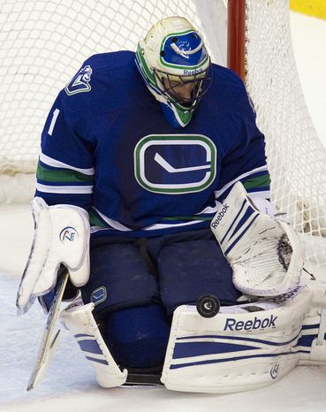 Vancouver Canucks goalie Roberto Luongo is 2-3-1 on the season with a 3.45 goals-against average and an .868 save percentage. (AP Photo/The Canadian Press, Jonathan Hayward)