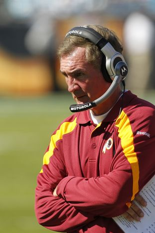 Washington Redskins' head coach Mike Shanahan will look for a bounce back effort from his defense against the Buffalo Bills on Sunday. (AP Photo/Bob Leverone)