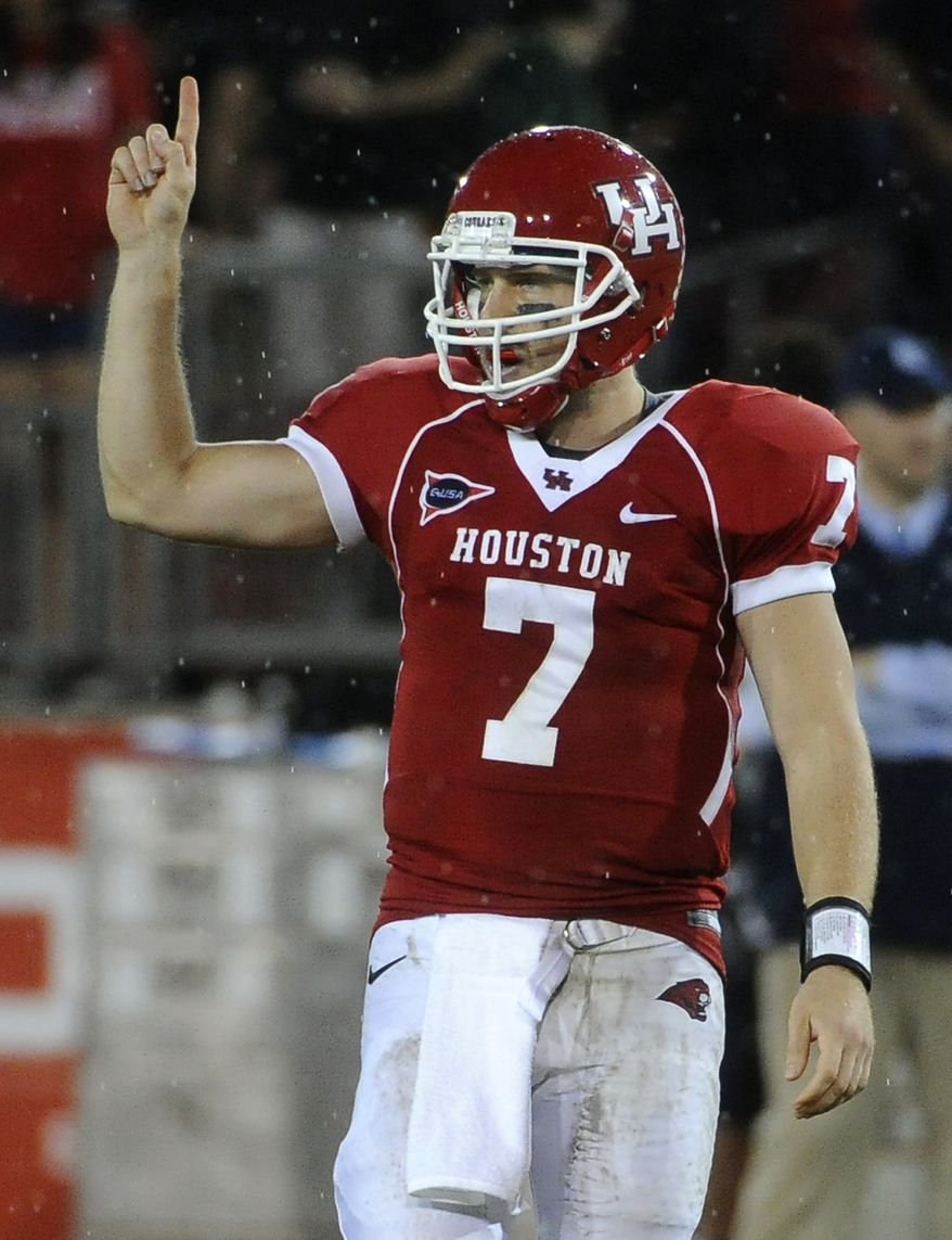 Houston quarterback Case Keenum signals for a play during the second half against Rice on Thursday, Oct. 27, 2011, in Houston. Houston won 73-34. (AP Photo/Pat Sullivan)