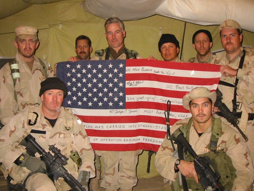 The special operations team Col. Bowers personally selected all signed a flag, which he carried on the mission, along with a piece of World Trade Center steel. (Army Special Operations Command)