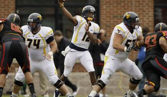 **FILE** West Virginia quarterback Geno Smith threw for a career-high 388 yards in a 37-31 win over Maryland on Sept. 17, 2011. He had one touchdown and an interception. (Associated Press)