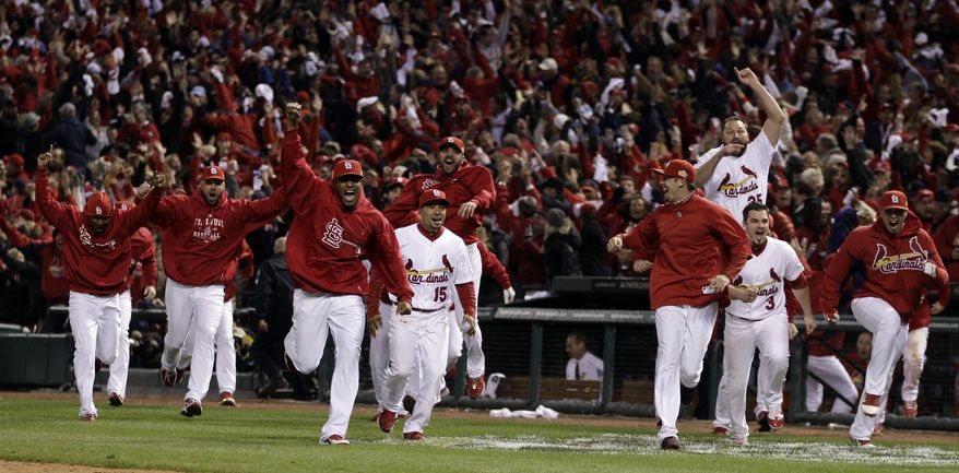 The St. Louis Cardinals bench erupts after David Freese hits a walk-off home run during the 11th inning of Game 6 of baseball's World Series against the Texas Rangers Thursday, Oct. 27, 2011, in St. Louis. The Cardinals won the game 10-9 to tie the series 3-3. (AP Photo/Matt Slocum)