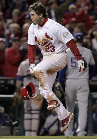 St. Louis Cardinals' David Freese reacts after hitting a walk-off home run during the 11th inning of Game 6 of the World Series against the Texas Rangers on Thursday, Oct. 27, 2011, in St. Louis. The Cardinals won the game 10-9 to tie the series 3-3. (AP Photo/Charlie Riedel)