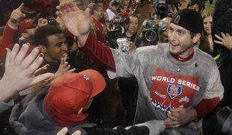 St. Louis Cardinals' David Freese celebrates after the Cardinals won the World Series, defeating the Texas Rangers 6-2 in Game 7. (AP Photo/Matt Slocum)