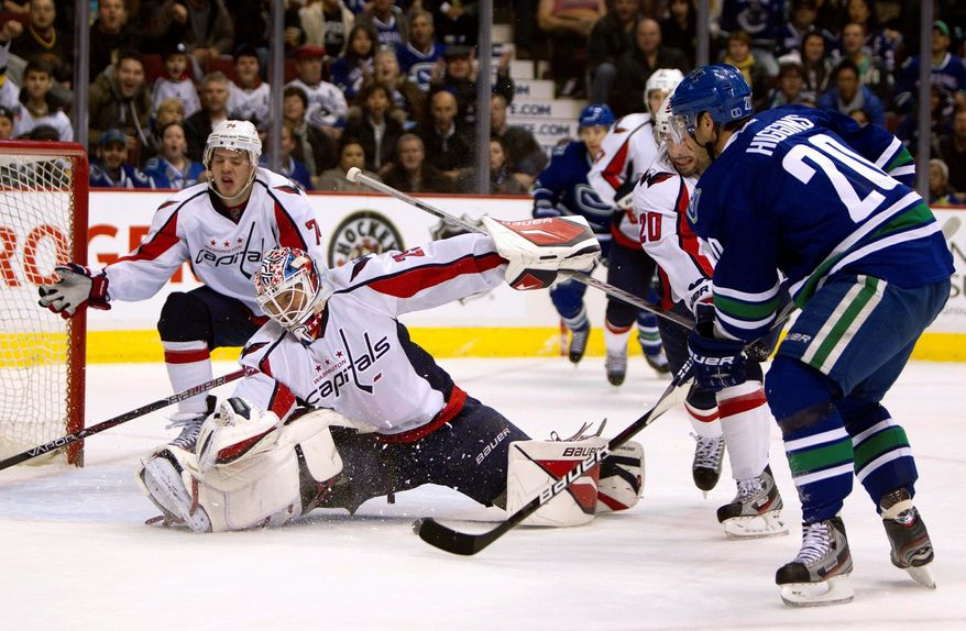 Capitals goalie Tomas Vokoun was pulled after giving up three goals in 17 shots during Saturday's loss. (Associated Press)
