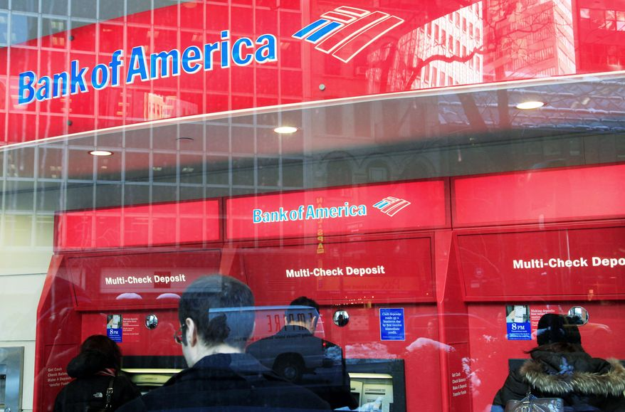 Bank of America customers use ATMs in New York. (Associated Press)