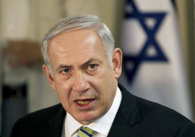 "Prime Minister Benjamin Netanyahu's agreement on the prisoner swap shifted Israel's focus ""on much more troubling fronts - in distant Iran and in the Arab revolutions around us,"" a journalist wrote. (Associated Press)"