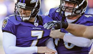 Kicker Billy Cundiff (left) is congratulated by long snapper Morgan Cox after his 25-yard field goal as time expired gave Baltimore a 30-27 win over Arizona. The Ravens trailed 24-3 at halftime. (Associated Press)