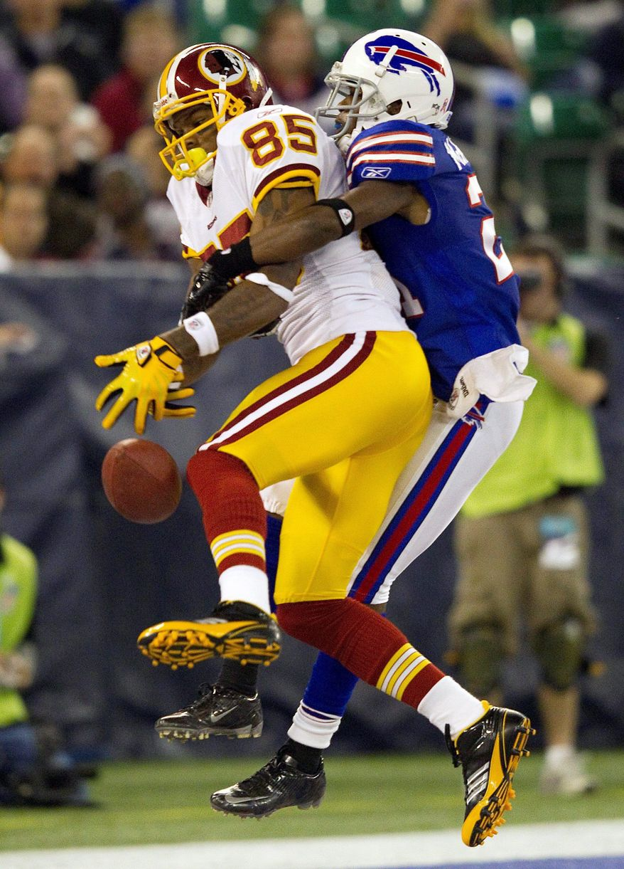 Redskins quarterback John Beck (s brought down by two Buffalo defenders during the second half of Sunday's loss in Tornonto. He was sacked nine times in the game. (Associated Press) Much like this pass intended for rookie receiver Leonard Hankerson, broken up by Bills cornerback Leodis McKelvin, the Redskins had a hard time getting a handle on anything against Buffalo in absorbing their third straight defeat. (Associated Press)