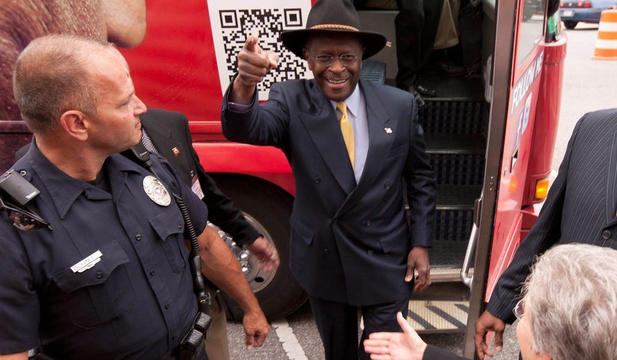 Republican presidential hopeful Herman Cain arrives at a campaign stop in Talladega, Ala., on Friday. Its name notwithstanding, the group Americans for Herman Cain is not affiliated with the campaign. (Associated Press)