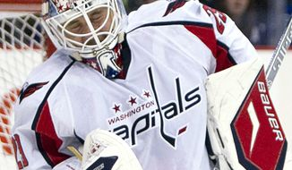 Washington Capitals goalie Tomas Vokoun (29) makes a save against the Vancouver Canucks during the first period of an NHL hockey game at Rogers Arena in Vancouver on Saturday, Oct. 29, 2011. (AP Photo/The Canadian Press, Jonathan Hayward)