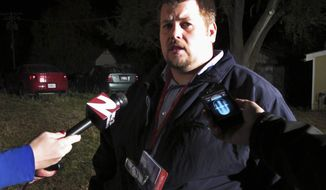 Atchison, Kan., City Manager Trey Cocking talks with reporters near the Bartlett Grain Co. elevator on Saturday, Oct. 29, 2011, after an explosion at the elevator killed three people and left three others missing. (AP Photo/John Hanna)