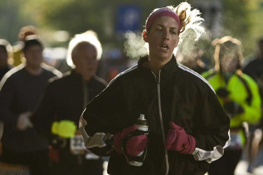 Kristy Seitz, of Berwyn Heights, Md., makes her way in to Rosslyn, Va. during the 36th Marine Corps Marathon on Oct. 30, 2011.
