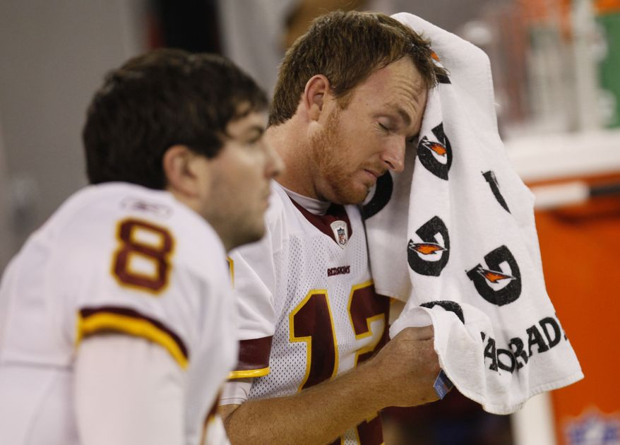Washington Redskins quarterback John Beck wipes his brow on the sidelines during the second half against the Buffalo Bills at the Rogers Centre in Toronto, Sunday, Oct. 30, 2011. (AP Photo/Derek Gee)